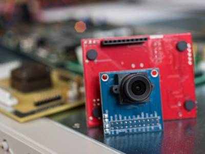 Camera with gesture recognition powered by harvested energy